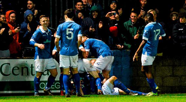 The Finn Harps players celebrate after Josh Maile scored the winning goal in injury time. SSE Airtricity League First Division Promotion / Relegation Play-off, Second Leg, Finn Harps v UCD, Finn Park, Ballybofey, Co. Donegal. Picture credit: Oliver McVeigh / SPORTSFILE