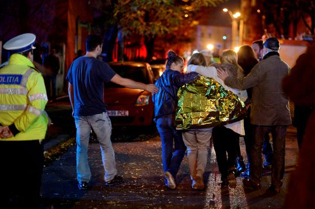 People walk outside a nightclub following an explosion in Bucharest, Romania REUTERS/Inquam Photos