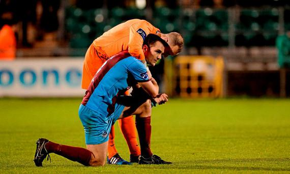 Michael Daly and goalkeeper Micheál Schlingermann, Drogheda United, react after the final whistle confirms their relegation following their loss to Shamrock Rovers Picture credit: Seb Daly / SPORTSFILE