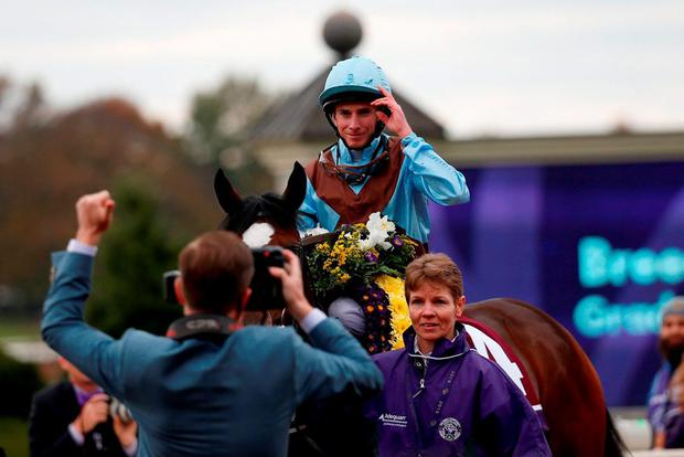 Jockey Ryan Moore tips his hat after riding Hit It A Bomb #14 to win the Breeder's Cup Juvenile Turf at Keeneland Racecourse