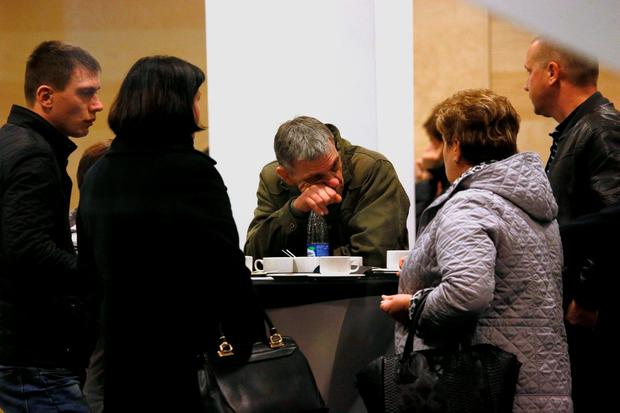 Relatives and the friends of those on the Metrojet flight that crashed in Egypt react as they gather at a hotel near St. Petersburg's Pulkovo airport outside St.Petersburg, Russia, Saturday, Oct. 31, 2015. (AP Photo/Dmitry Lovetsky)