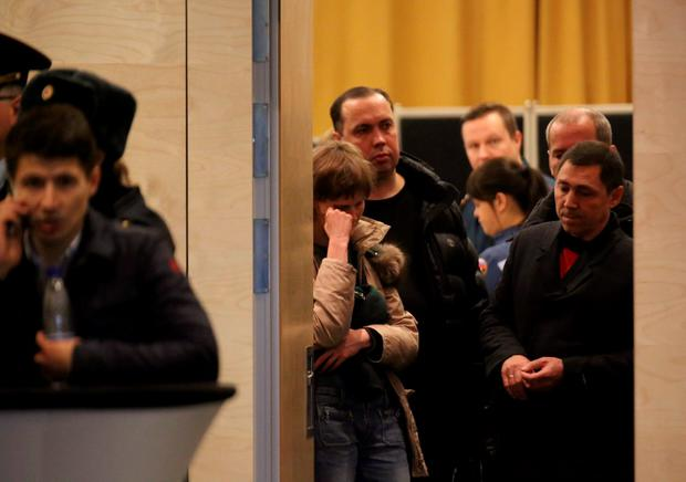 Relatives of victims of a Russian airliner which crashed in Egypt, mourn at a hotel near Pulkovo airport in St. Petersburg, Russia, October 31, 2015. The Airbus A321, operated by Russian airline Kogalymavia under the brand name Metrojet, carrying 224 passengers and crew crashed in Egypt's Sinai peninsula on Saturday after losing radar contact and plummeting from its cruising altitude, killing all aboard. REUTERS/Peter Kovalev