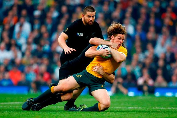 Michael Hooper of Australia is tackled during the 2015 Rugby World Cup Final match between New Zealand and Australia at Twickenham