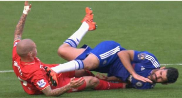 Diego Costa kicks Martin Skrtel in the chest