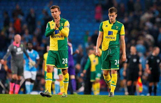 Football - Manchester City v Norwich City - Barclays Premier League - Etihad Stadium - 31/10/15 Norwich's Gary O'Neil and Ryan Bennett look dejected at the end of the match Action Images via Reuters / Jason Cairnduff Livepic EDITORIAL USE ONLY. No use with unauthorized audio, video, data, fixture lists, club/league logos or