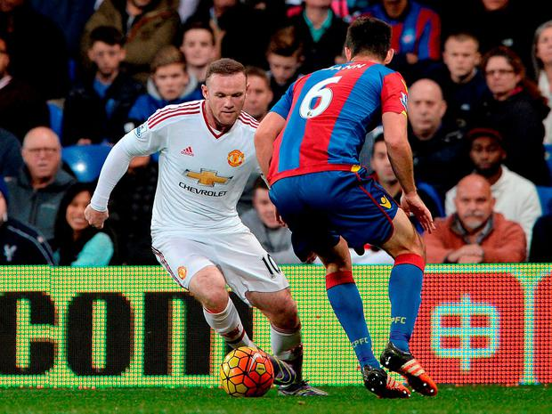 Manchester United's Wayne Rooney (left) and Crystal Palace's Scott Dann in action during the Barclays Premier League match at Selhurst Park, London. PRESS ASSOCIATION Photo. Picture date: Saturday October 31, 2015. See PA story SOCCER Palace. Photo credit should read: Anthony Devlin/PA Wire. RESTRICTIONS: EDITORIAL USE ONLY No use with unauthorised audio, video, data, fixture lists, club/league logos or