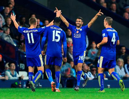 Leicester City's Riyad Mahrez (2nd right) celebrates scoring his side's first goal of the game during the Barclays Premier League match at The Hawthorns, West Bromwich. PRESS ASSOCIATION Photo. Picture date: Saturday October 31, 2015. See PA story SOCCER West Brom. Photo credit should read: Nigel French/PA Wire. RESTRICTIONS: EDITORIAL USE ONLY No use with unauthorised audio, video, data, fixture lists, club/league logos or