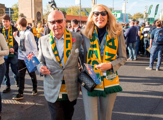 News Corp Executive Chairman Rupert Murdoch arriving with Jerry Hall at Twickenham in south west London to support Australia in the Rugby World Cup final.