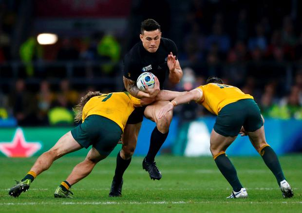 Sonny Bill Williams of New Zealand (C) is tackled by Scott Sio (L) and Bernard Foley (R) of Australia during their Rugby World Cup Final at Twickenham in London, October 31, 2015. REUTERS/Stefan Wermuth