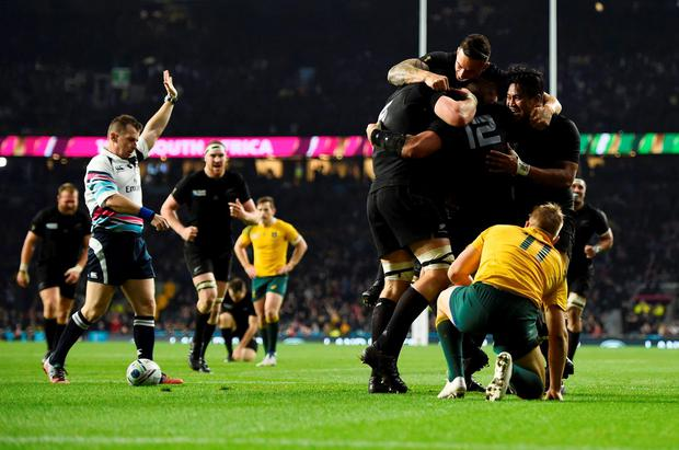 New Zealand players celebrate after scoring a try during their Rugby World Cup final match against Australia at Twickenham in London, Britain, October 31, 2015. REUTERS/Dylan Martinez