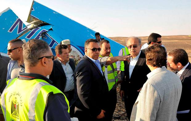 Egypt's Prime Minister Sherif Ismail (4rth R) listen to Egyptian team from police and army at the remines of a plane crash at the desert in central Sinai near El Arish city north of Egypt, October 31, 2015. REUTERS/Stringer