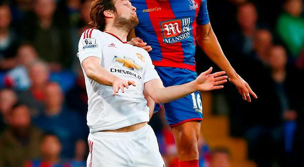 Dwight Gayle of Crystal Palace and Daley Blind of Manchester United compete for the ball