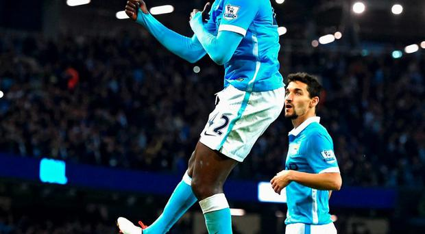 Yaya Toure of Manchester City celebrates scoring his team's second goal from the penalty spot