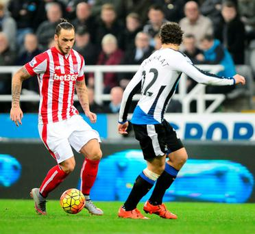 Newcastle United's Daryl Janmaat and Stoke City's Marko Arnautovic