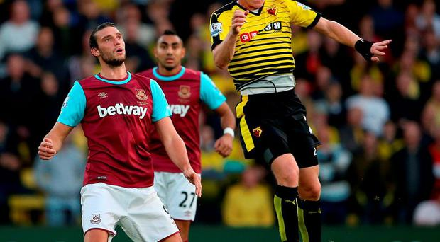 Watford's Ben Watson beats West Ham's Andy Carroll in the air