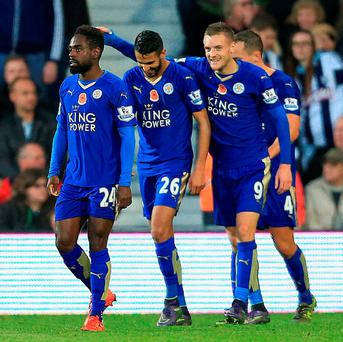 Leicester City's Jamie Vardy celebrates scoring his side's third goal of the game with his teammates