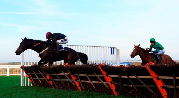 Nabucco ridden by Aidan Coleman (left) jumps the last on the way to winning The William Hill Handicap Hurdle during the Halloween Raceday at Ascot