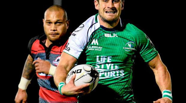 Tiernan O'Halloran breaks free to score a try for Connacht in their win against Edinburgh last night
