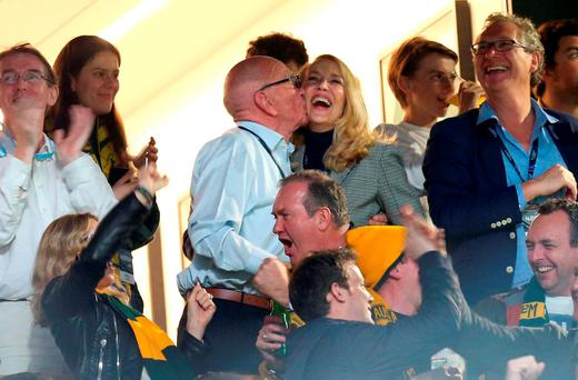 Rupert Murdoch and Jerry Hall celebrate with a kiss in the stands after Australia score their second try during the Rugby World Cup Final at Twickenham, London