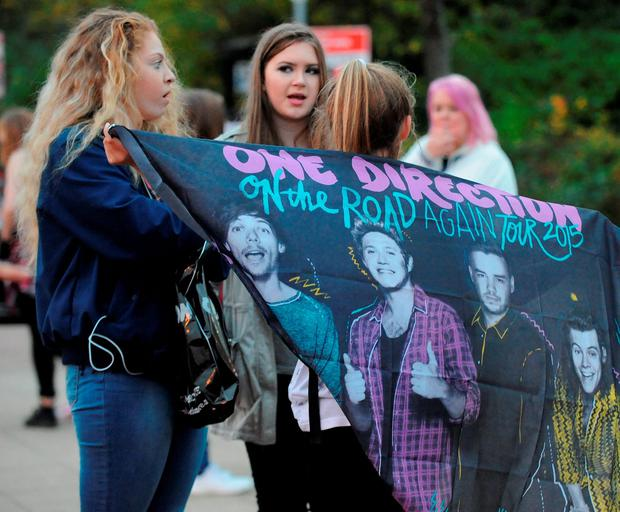 One Direction fans outside the Sheffield Arena, Sheffield, ahead of the conclusion of the band's On The Road Again Tour in Sheffield tonight. Rui Vieira/PA Wire