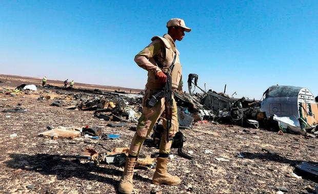 An Egyptian army soldier stands guard near debris from a Russian airliner at its crash siteat the Hassana area in Arish city, north Egypt, November 1, 2015. Russia has grounded Airbus A321 jets flown by the Kogalymavia airline, Interfax news agency reported on Sunday, after one of its fleet crashed in Egypt's Sinai Peninsula, killing all 224 people on board. REUTERS/Mohamed Abd El Ghany