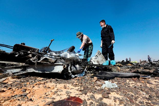 Military investigators from Russia check debris from a Russian airliner at its crash site at the Hassana area in Arish city, north Egypt, November 1, 2015. REUTERS/Mohamed Abd El Ghany