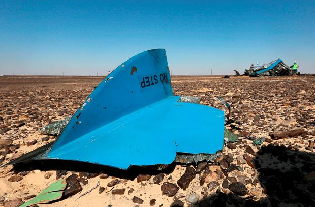 The debris from a Russian airliner is seen at its crash site at the Hassana area in Arish city, north Egypt, November 1, 2015. REUTERS/Mohamed Abd El Ghany