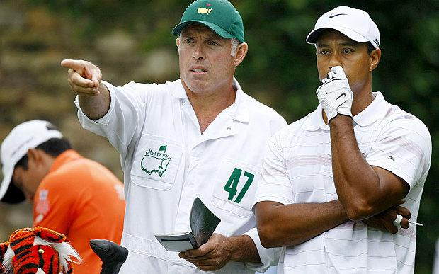 War of words: Caddie Steve Williams (left) has criticised Tiger Woods
