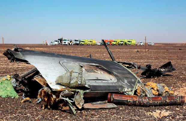 The remains of a Russian airliner are seen at the crash site as rescue crews wait in the al-Hasanah area in El Arish city, north Egypt REUTERS/Mohamed Abd El Ghany