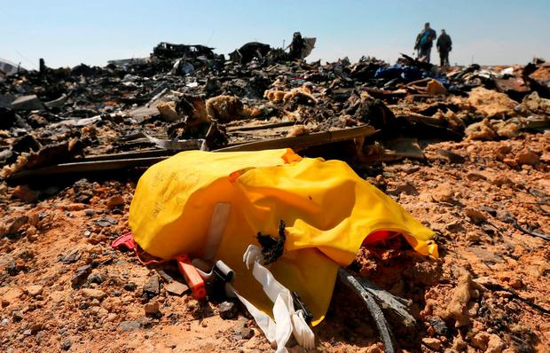 The remains of a Russian airliner are seen as military investigators inspect the crash site in al-Hasanah area in El Arish city, north Egypt REUTERS/Mohamed Abd El Ghany