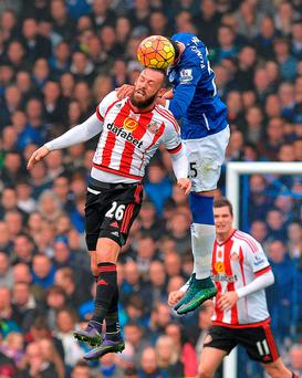 Sunderland's Steven Fletcher (left) and Everton's Ramiro Funes Mori battle for the ball during the Barclays Premier League match at Goodison Park, Liverpool Credit: Martin Rickett/PA Wire.