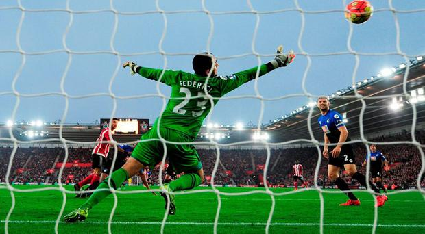 Graziano Pelle heads the ball past goalkeper Adam Federici of Bournemouth to score their second goal at the St Mary's Stadium