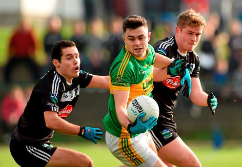 Michael Quinlivan, Clonmel Commercials, in action against Newcastle West's Michael O'Leary (left), and Brian O'Sullivan in the AIB Munster GAA Senior Club Football Championship Quarter-Final