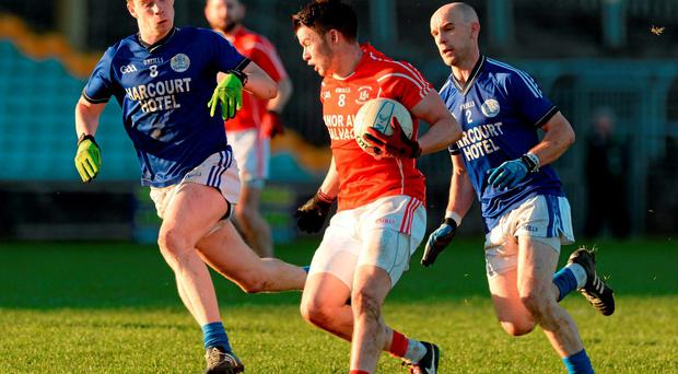 Trillick's Richard Donnelly, Trillick, in action against Ciaran Thompson and Aaron Thompson, Naomh Conaill, during their AIB Ulster GAA Senior Club Football Championship Quarter-Finals