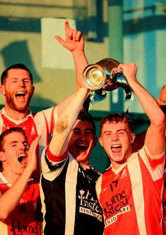 Cuala's Seán Brennan and Jake Malone (right) celebrate with the cup after beating St Jude's in Saturday's Dublin SHC fina