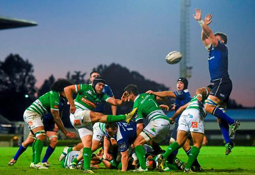 Treviso's Edoardo Gori clears under pressure from Jordi Murphy during the Guinness PRO12 Round 6 clash