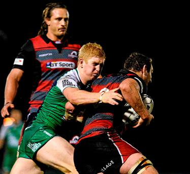 Connaght's Darragh Leader tackles Edinburgh's Mike Coman during the match