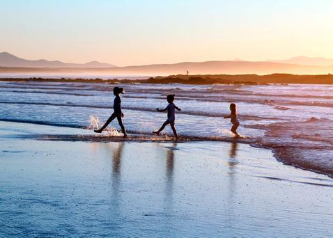 Children play on a beach in Ballybunion, Co Kerry