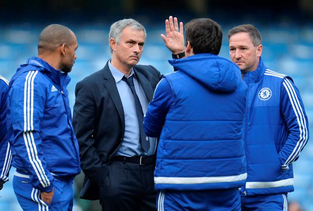 Chelsea manager Jose Mourinho with staff after the match