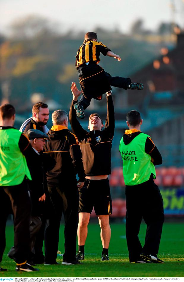 1 November 2015; Mel Boyce, from Crossmaglen Rangers, celebrates with six year old Cormac McEntee after the game. AIB Ulster GAA Senior Club Football Championship, Quarter-Finals, Crossmaglen Rangers v Erins Own Cargin. Athletics Grounds, Armagh. Picture credit: Paul Mohan / SPORTSFILE