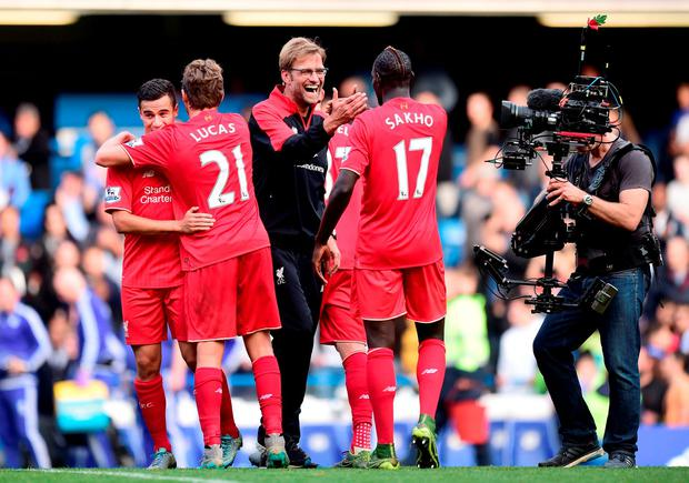 Liverpool manager Jurgen Klopp (left) celebrates victory with Mamadou Sakho (right) after the Barclays Premier League match at Stamford Bridge, London