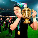 New Zealand's Dan Carter celebrates with the Webb Ellis Cup after the Rugby World Cup Final at Twickenham, London