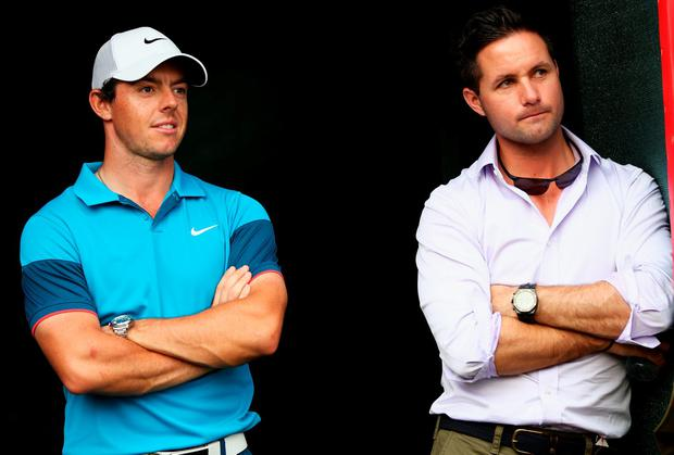 Rory McIlroy of Northern Ireland looks on, with his agent Sean O'Flaherty after the final day of the Abu Dhabi HSBC Golf Championship at Abu Dhabi Golf Club on January 18, 2015 in Abu Dhabi, United Arab Emirates. (Photo by Matthew Lewis/Getty Images)
