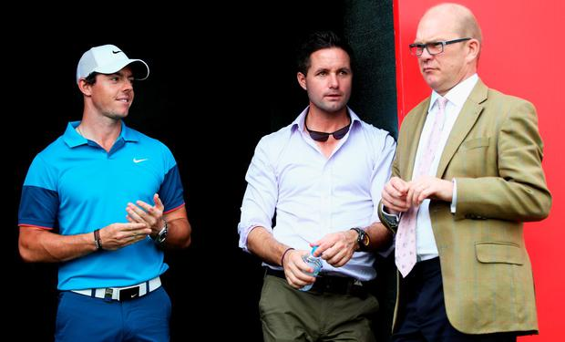 Rory McIlroy of Northern Ireland looks on, with his agent Sean O'Flaherty and Guy Kinnings, global head of golf for IMG after the final day of the Abu Dhabi HSBC Golf Championship at Abu Dhabi Golf Club on January 18, 2015 in Abu Dhabi, United Arab Emirates. (Photo by Matthew Lewis/Getty Images)