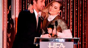 Actor Ryan Gosling (L) presents the New Hollywood Award for Brooklyn to honoree Saoirse Ronan onstage during the 19th Annual Hollywood Film Awards at The Beverly Hilton Hotel on November 1, 2015 in Beverly Hills, California. (Photo by Kevin Winter/Getty Images)