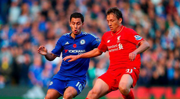 Eden Hazard of Chelsea and Lucas Leiva of Liverpool compete for the ball