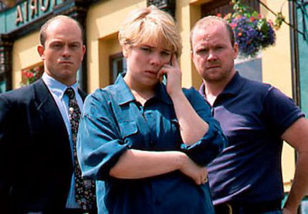 Ross Kemp as Grant, Laetitia Dean as Sharon, and Steve McFadden as Phil Mitchell