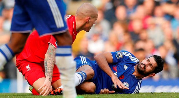 Chelsea's Diego Costa clashes with Liverpool's Martin Skrtel Action Images via Reuters / John Sibley