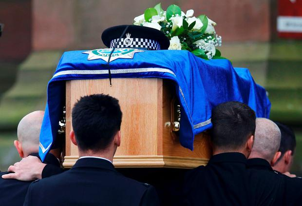 The coffin of police officer Dave Phillips is carried into at Liverpool Anglican Cathedral for his funeral service, in Liverpool, Britain November 2, 2015. Phillips was killed when he was struck by a car whilst on duty. REUTERS/Darren Staples