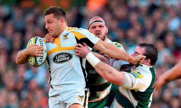 Wasps' Jimmy Gopperth (left) is tackled by Leicester Tigers' Lachlan McCaffrey (centre) and Fraser Balmain (right) during the Aviva Premiership match at Welford Road